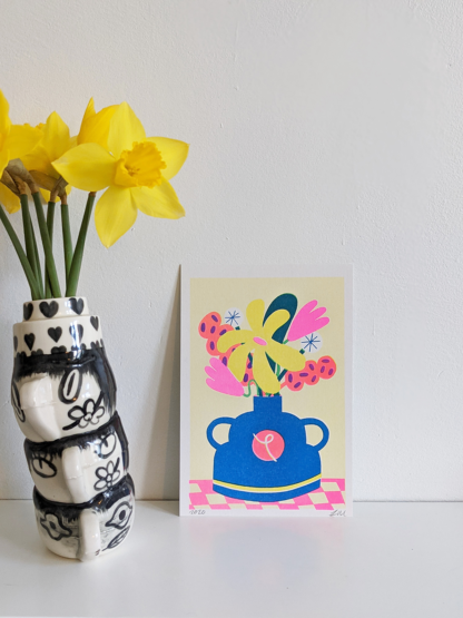 framed stylised risograph printed illustration of a vase and flowers