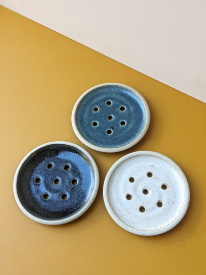 three handmade ceramic crafted soap dishes in various glaze colours
