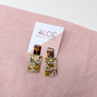 tortoiseshell stud earrings with a caramel marbled rectangular pendant attachment