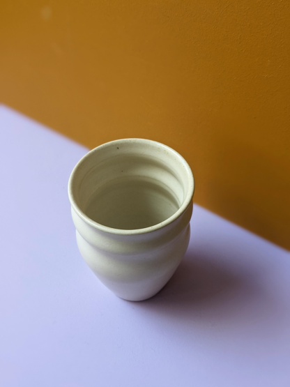 handmade crafted organic cream ceramic ritual cup taken from high angle
