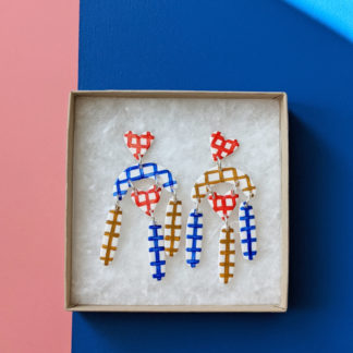 Handmade fimo clay heart and arch checkered dangle shape earrings sat in a gift box