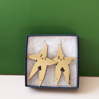 stylised large gold nude star earrings