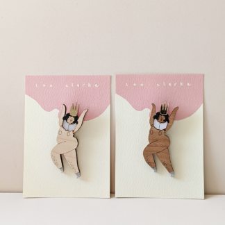 pair of wood laser cut naked dancers wearing a crown brooches