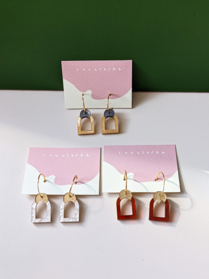 three pairs of gold and multicoloured arched window earring pendants
