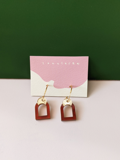 pair of tortoiseshell and gold arched hooped earrings