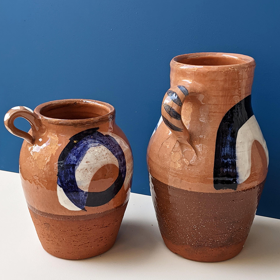 Two handmade terracotta ceramic crafted jugs with cobalt blue glaze