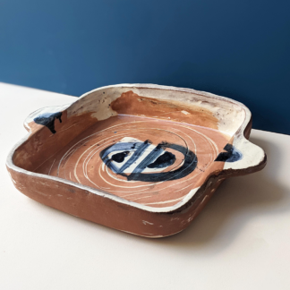 handmade terracotta crafted shallow oven dish with navy and white glaze decoration