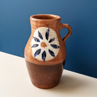 handmade terracotta crafted tall jug with flower glaze decoration